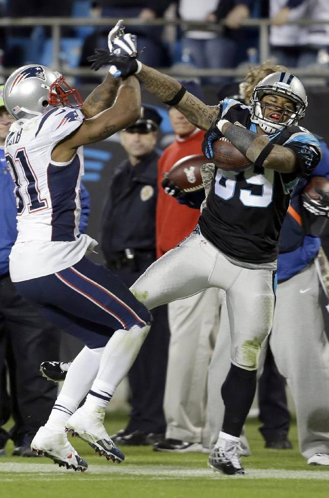Carolina Panthers' Steve Smith (89) is knocked out of bounds by New England Patriots' Aqib Talib (31) during the second half of an NFL football game in Charlotte, N.C., Monday, Nov. 18, 2013
