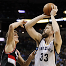 Memphis Grizzlies center Marc Gasol (33), of Spain, shoots against Portland Trail Blazers center Meyers Leonard, left, in the second half of an NBA basketball game on Tuesday, March 11, 2014, in Memphis, Tenn. Gasol led the Grizzlies with 19 points as the
