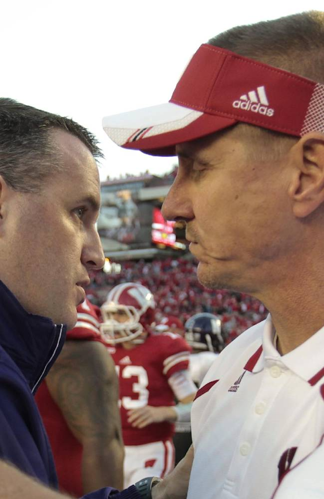 Northwestern coach Pat Fitzgerald, left, and Wisconsin coach Gary Andersen greet each ofter Wisconsin beat Northwestern 35-6 in an NCAA college football game in Madison, Wis., Saturday, Oct. 12, 2013