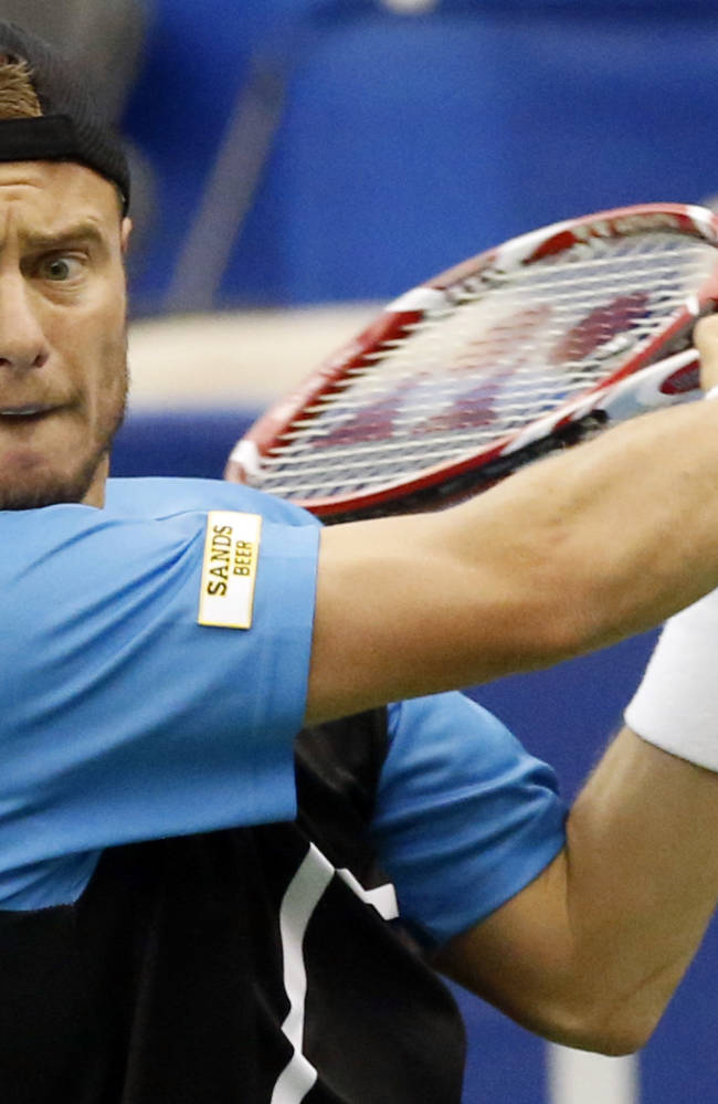 Lleyton Hewitt, of Australia, watches the ball as he hits a return to Michael Russell in the quarterfinal match at the U.S. National Indoor Tennis Championships, Friday, Feb. 14, 2014 in Memphis, Tenn