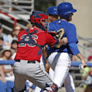 Minnesota Twins catcher Eric Fryer (26) tags Toronto Blue Jays pinch-runner Dan Johnson after catching Johnson in a rundown between home and third in the sixth inning of a spring training baseball game in Dunedin, Fla., Saturday, March 8, 2014. The Jays d