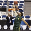 Oregon forward Arsalan Kazemi goes up with a shot during practice for a regional semifinal game in the NCAA college basketball tournament Thursday, March 28, 2013, in Indianapolis. Oregon plays Louisville on Friday. (AP Photo/Darron Cummings)
