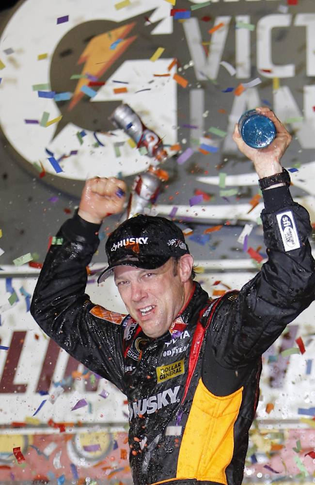 In this May 11, 2013 file photo, Matt Kenseth celebrates in Victory Lane after winning the NASCAR Sprint Cup series auto race at Darlington Raceway in Darlington, S.C. Kenseth hopes a second straight win at Darlington Raceway will lock him into the championship chase this weekend