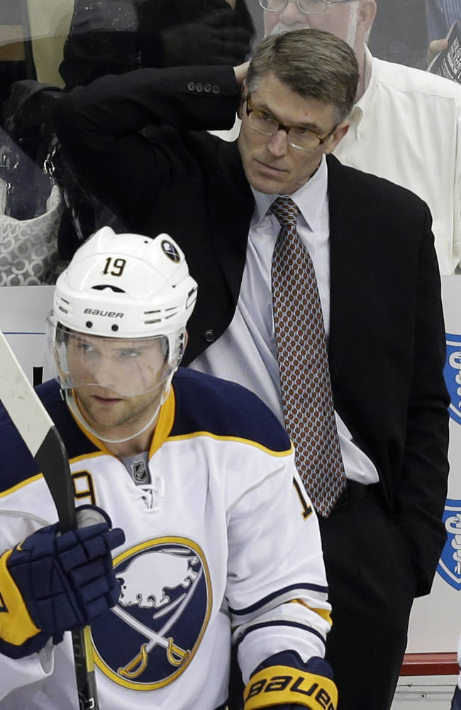 In this April 23, 2013 file photo, Buffalo Sabres head coach Ron Rolston stands behind his bench in the third period of an NHL hockey game against the Pittsburgh Penguins in Pittsburgh. In the foreground is Sabres' Cody Hodgson (19). The Sabres have fired coach Rolston and rehired Ted Nolan to replace him. Sabres owner Terry Pegula also announced Wednesday, Nov. 13, 2013, that he fired general manager Darcy Regier and hired Pat LaFontaine as president of hockey operations