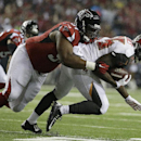 Atlanta Falcons defensive tackle Corey Peters (91) tackles Tampa Bay Buccaneers running back Mike James (25) during the first half of an NFL football game, Thursday, Sept. 18, 2014, in Atlanta The Associated Press