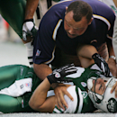 In this Sunday, Nov. 6, 2005, file photo, New York Jets' Wayne Chrebet lies unconscious while a San Diego Chargers trainer looks over him after he took a hit on a reception during the fourth quarter of an NFL football game, in East Rutherford, N.J. Chrebe