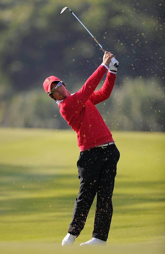 Asian team's Ryo Ishikawa, of Japan, follows the ball on the 15th hole during his Foursomes Match with Japanese teammate Hiroyuki Fujita against European team's Nicolas Colsaerts, of Belgium, and Bernd Wiesberger, of Austria, at the Royal Trophy-Europe vs. Asia Golf Championship at Dragon Lake Golf Club in Guangzhou, in south China's Guangdong province, Friday, Dec. 20, 2013