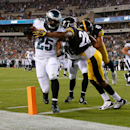 Philadelphia Eagles' LeSean McCoy (35) scores a touchdown past Pittsburgh Steelers' Cortez Allen (28) during the first half of an NFL preseason football game, Thursday, Aug. 21, 2014, in Philadelphia. (AP Photo/Matt Rourke)