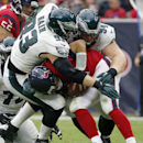 Houston Texans quarterback Ryan Fitzpatrick is sacked for an 8-yard loss by Philadelphia Eagles defensive end Brandon Bair, top left, and defensive tackle Beau Allen, top right, during the first quarter of an NFL football game, Sunday, Nov. 2, 2014, in Ho