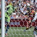 Real Salt Lake forward Joao Plata sends a header into the net past Seattle Sounders goalkeeper Stefan Frei early in the second half of an MLS soccer game Saturday, Aug. 16, 2014, in Sandy, Utah The Associated Press