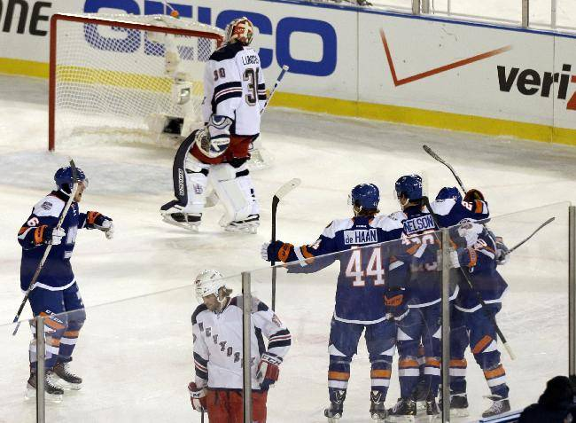 New York Rangers goalie Henrik Lundqvist (30) and teammate Benoit Pouliot (67) react as the New York Islanders celebrate a goal by Brock Nelson during the second period of an outdoor NHL hockey game  Wednesday, Jan. 29, 2014, at Yankee Stadium in New York