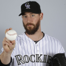 Rockies pitcher Axford's son improves following snake bite The Associated Press