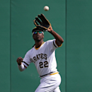 Pittsburgh Pirates' Andrew McCutchen runs down a fly ball hit by St. Louis Cardinals' Matt Carpenter to end the top of the eighth inning during a baseball game in Pittsburgh, Sunday, April 6, 2014. The Pirates won 2-1 The Associated Press