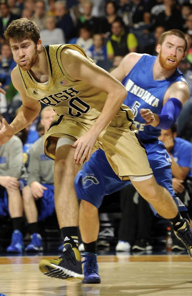 Notre Dame forward Austin Burgett, left, has the ball slapped away by Indiana State forward Justin Gant during the first half of an NCAA college basketball game Sunday, Nov. 17, 2013, in South Bend, Ind