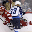 Winnipeg Jets' Dustin Byfuglien (33) checks Phoenix Coyotes' Chris Summers (20) into the boards during the third period of an NHL hockey game, Tuesday, April 1, 2014, in Glendale, Ariz. The Jets defeated the Coyotes 2-1 in a shootout The Associated Press