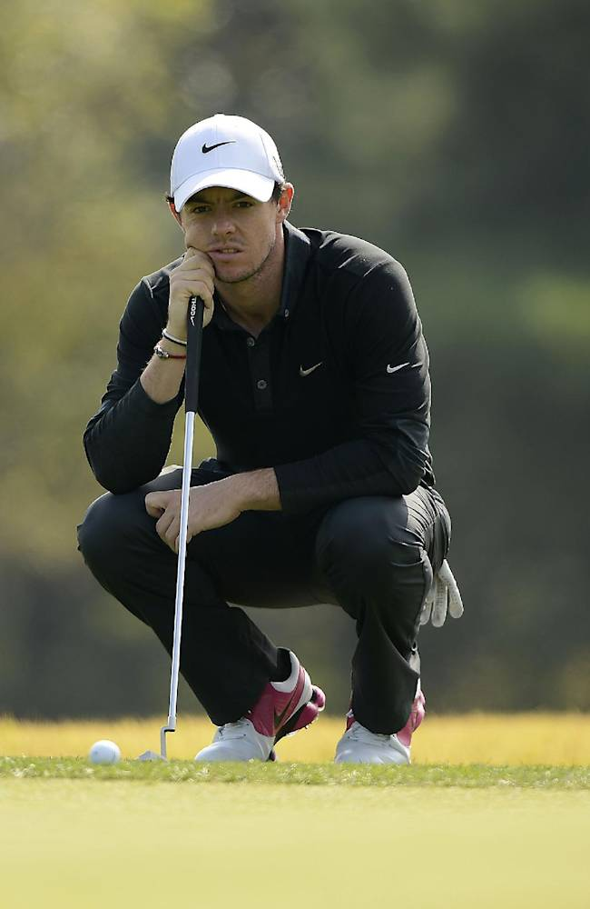 In this photo released by OneAsia, Rory McIlroy of Northern Ireland lines up a putt during the first round of the Korea Open golf tournament at Woo Jeong Hills Country Club near Cheonan, South Korea Thursday, Oct. 17, 2013