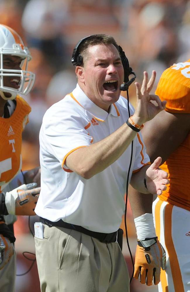 Tennessee head coach Butch Jones screams at his players from the sidelines as the final seconds tick off in the second half against South Alabama in an NCAA college football game at Neyland Stadium in Knoxville, Tenn. on Saturday, Sept. 28, 2013