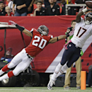 Chicago Bears wide receiver Alshon Jeffery (17) makes the catch but out of bounds against Atlanta Falcons free safety Dwight Lowery (20) during the first half of an NFL football game, Sunday, Oct. 12, 2014, in Atlanta The Associated Press