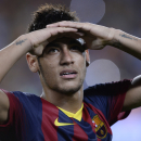 FC Barcelona's Neymar from Brazil, gestures after winning the Spanish Super Cup against Atletico Madrid at the Camp Nou stadium in Barcelona, Spain, Wednesday, Aug. 28, 2013. (AP Photo/Manu Fernandez)