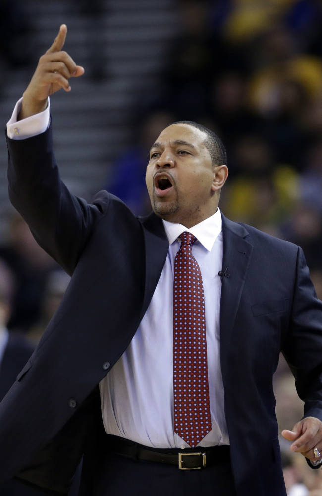 Golden State Warriors head coach Mark Jackson instructs his team against the Chicago Bulls during the first half of an NBA basketball game, Thursday, Feb. 6, 2014, in Oakland, Calif