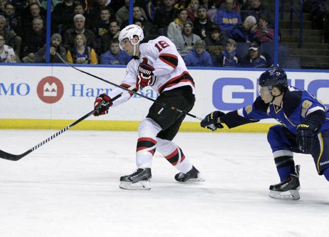 New Jersey Devils' Steve Bernier (18) fires the puck as St. Louis Blues' Ian Cole (28) tries to poke at him in the first period of an NHL hockey game, Tuesday, Jan. 28, 2014 in St. Louis