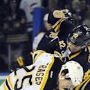 Buffalo Sabres' Marcus Foligno (82) throws a punch at Boston Bruins' Nick Fraser (25) during a fight in the first period of an NHL hockey game in Buffalo, N.Y., Thursday, Dec. 19, 2013. (AP Photo/Gary Wiepert)