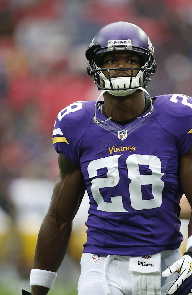 Adrian Peterson back at practice, says he'll play