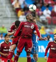 Toronto FC's Jeremy Hall heads the ball against a Philadelphia Union player during the second half of their MLS soccer game in Toronto, Saturday, June 1, 2013. (AP Photo/The Canadian Press, Aaron Vincent Elkaim)
