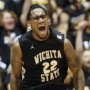 Wichita State's Carl Hall celebrates after making a basket against Creighton during the first half of an NCAA college basketball game on Saturday, Jan. 19, 2013 at Charles Koch Arena in Wichita, Kan. (AP Photo/The Wichita Eagle, Travis Heying)