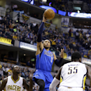 Dallas Mavericks forward Shawn Marion, center, shoots between Indiana Pacers guard Lance Stephenson (1) and center Roy Hibbert (55) during the first half of an NBA basketball game in Indianapolis, Wednesday, Feb. 12, 2014 The Associated Press