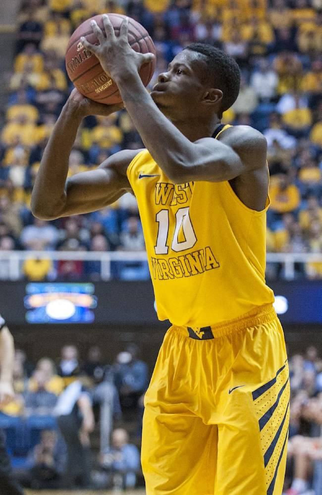 West Virginia's Eron Harris (10) looks to shoot a 3-point shot during the second half of an NCAA college basketball game against Kansas, Saturday, March 8, 2014, in Morgantown, W.Va. West Virginia won 92-86