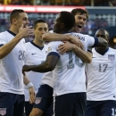 USA's Eddie Johnson (18), second from right, is hugged by USA's Brad Evans, upper right, after Johnson scored a goal against Panama in the second half of a World Cup qualifier soccer match, Tuesday, June 11, 2013, in Seattle. Looking on at left is Geoff Cameron (20) and at right is Jozy Altidore (17). USA defeated Panama, 2-0. (AP Photo/Ted S. Warren)
