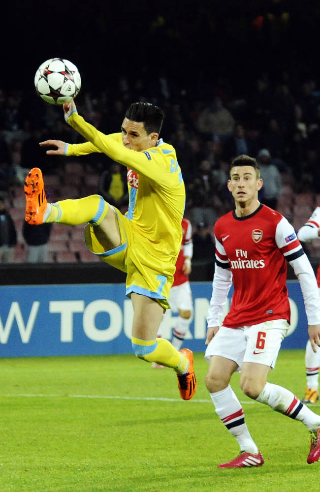 Napoli's Jose Callejon reaches for the ball during a Champions League, group F, soccer match between Napoli and Arsenal, at the Naples San Paolo stadium, Italy, Wednesday, Dec. 11, 2013