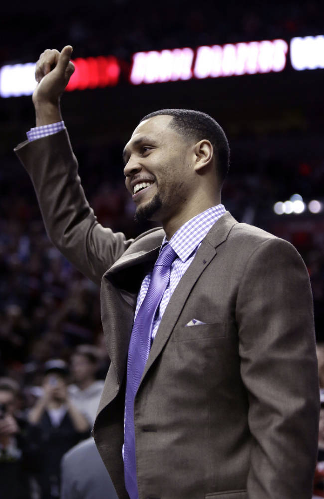 Minnesota Timberwolves and former Portland Trail Blazers guard Brandon Roy acknowledges a cheering crowd during a first-quarter time out at an NBA basketball game between the teams in Portland, Ore., Saturday, March 2, 2013. Roy is currently on the injured/inactive list