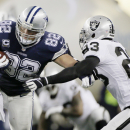 Dallas Cowboys tight end Jason Witten (82) is tackled by Oakland Raiders cornerback Tracy Porter (23) during the first half of an NFL football game, Thursday, Nov. 28, 2013, in Arlington, Texas The Associated Press