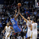 Oklahoma City Thunder small forward Kevin Durant (35) shoots over New Orleans Pelicans power forward Ryan Anderson, shooting guard Eric Gordon (10) and center Jason Smith (14) in the second half of an NBA basketball game in New Orleans, Friday, Dec. 6, 20