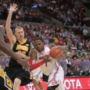 Ohio State's Deshaun Thomas, right, drives to the basket against Iowa's Aaron White during the second half of an NCAA college basketball game Tuesday, Jan. 22, 2013, in Columbus, Ohio. Ohio State won 72-63. (AP Photo/Jay LaPrete)