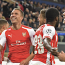 Teammates celebrate with Arsenal's Lukas Podolski, second left, who scored the decisive goal during the Group D Champions League match between Anderlecht and Arsenal at Constant Vanden Stock Stadium in Brussels, Belgium, Wednesday Oct. 22, 2014