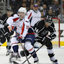Washington Capitals center Nicklas Backstrom, left, and Los Angeles Kings left wing Dwight King battle for the puck during the first period of an NHL hockey game, Thursday, March 20, 2014, in Los Angeles The Associated Press