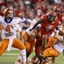 In this Sept. 27, 2014, file photo, Nebraska defensive end Randy Gregory (4) is stopped by Illinois' Simon Cvijanovic, second from left, and Chris O'Connor, right, as Illinois quarterback Reilly O'Toole (4) throws the ball in the second half of an NCAA co