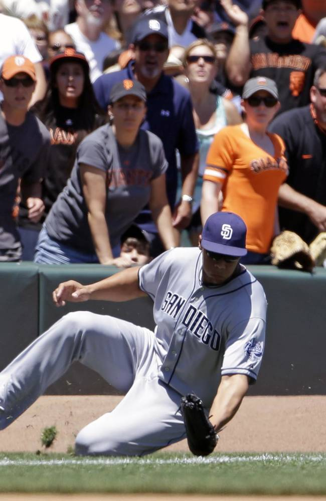 San Diego Padres right fielder Kyle Blanks misses a fly ball hit by San Francisco Giants' Brandon Belt during the fourth inning of their baseball game on Wednesday, June 19, 2013 in San Francisco. Giants' Hunter Pence scored a run on the play
