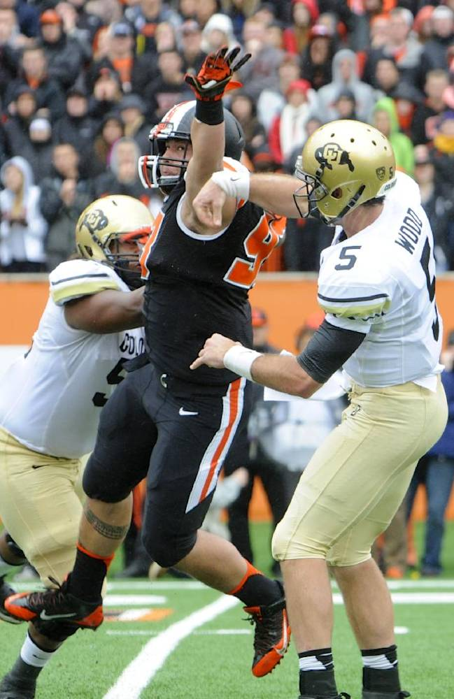 Oregon State's Mana Rosa (93) deflects a throw by Colorado quarterback Connor Wood (5) in the first half of an NCAA college football game on Saturday, Sept 28, 2013, in Corvallis, Ore