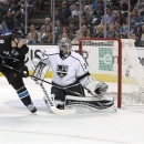 Los Angeles Kings goalie Jonathan Quick (32) blocks a goal attempt by San Jose Sharks center Logan Couture (39) during the first period in Game 3 of their second-round NHL hockey Stanley Cup playoff series, Saturday, May 18, 2013, in San Jose, Calif. (AP Photo/Tony Avelar)