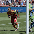 Real Salt Lake forward Joao Plata rushes to congratulate Luke Mulholland after Mulholland's shot gave the team a 2-0 lead early in the second half against the Seattle Sounders in an MLS soccer game Saturday, Aug. 16, 2014. The goal was listed as an