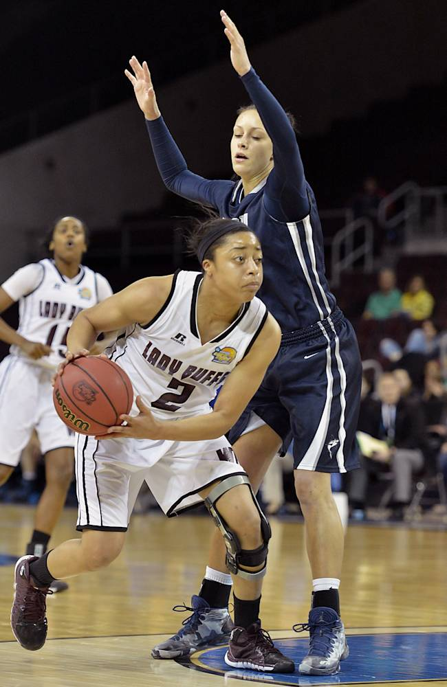West Texas A&M's Devin Griffin drives to the hoop past Nova Southeastern's Jessica Russi during the second half in an NCAA women's Division II basketball tournament semifinal in Erie, Pa., on Wednesday, March 26, 2014
