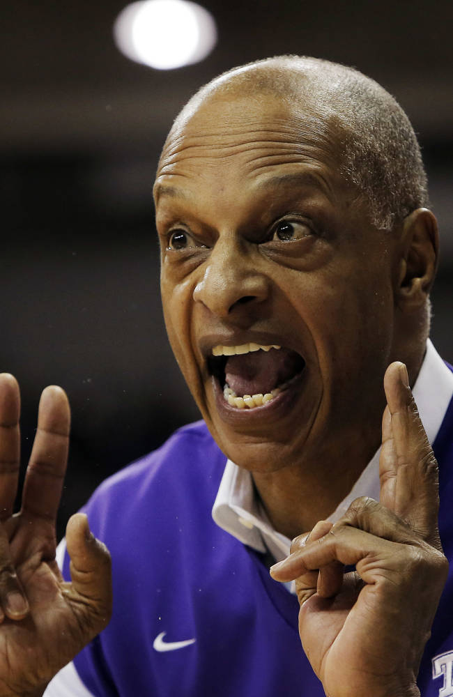 TCU head coach Trent Johnson shouts instructions to his players in the first half of an NCAA college basketball game against Kansas, Saturday, Jan. 25, 2014, in Fort Worth, Texas. Kansas won 91-69