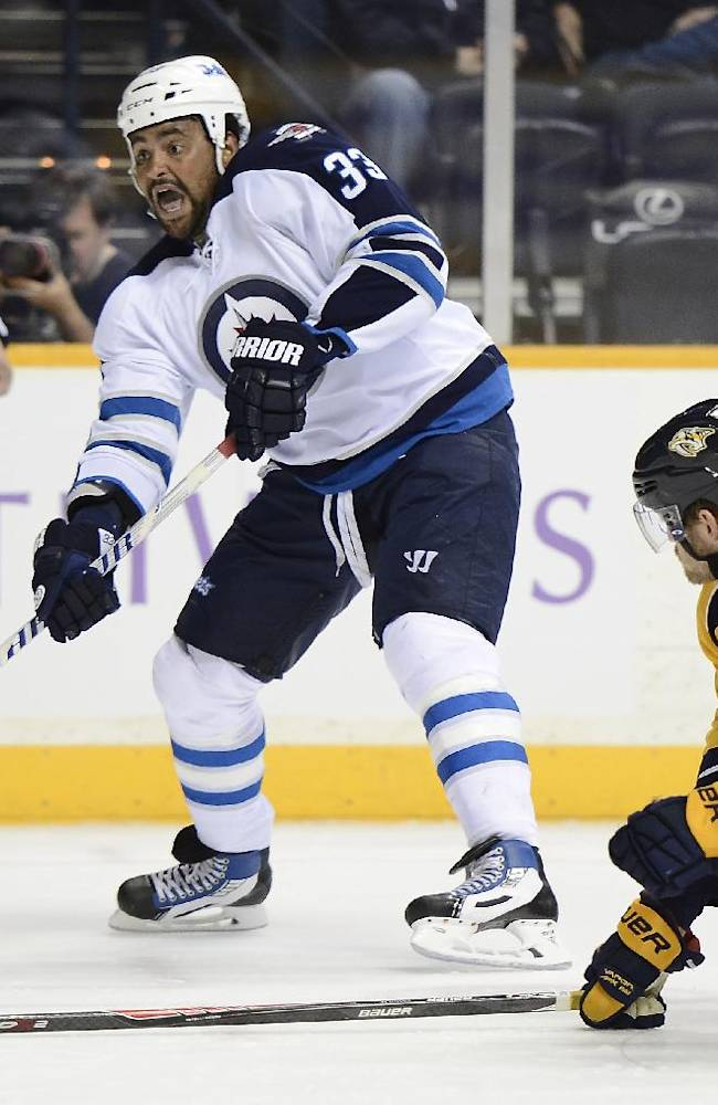 Winnipeg Jets defenseman Dustin Byfuglien (33) takes the puck past Nashville Predators defenseman Mattias Ekholm (42), of Sweden, in the first period of an NHL hockey game on Saturday, March 1, 2014, in Nashville, Tenn