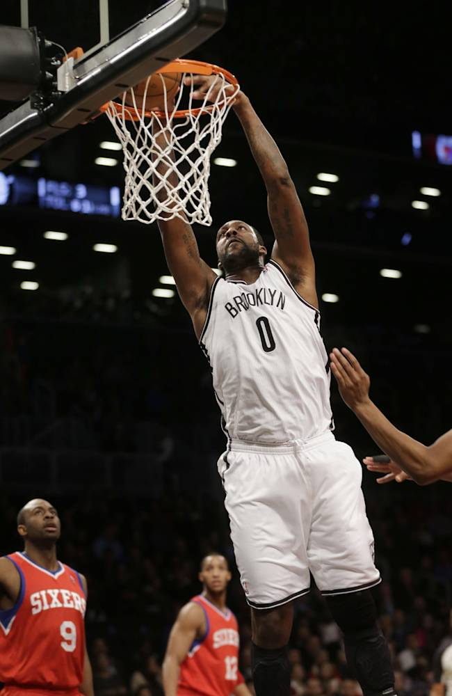 Brooklyn Nets' Andray Blatche dunks the ball during the first half of an NBA basketball game against the Philadelphia 76ers at the Barclays Center, Monday, Dec. 16, 2013, in New York