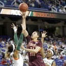 Virginia Tech's Monet Tellier, center, shoots between Miami's Morgan Stroman, left, and Michelle Woods, right, during the first half of an NCAA college basketball Atlantic Coast Conference tournament game in Greensboro, N.C., Thursday, March 7, 2013. (AP Photo/Chuck Burton)