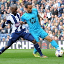 Tottenham Hotspur's Aaron Lennon, right, battles for the ball with West Bromwich Albion's Youssuf Mulumbu during the English Premier League soccer match at The Hawthorns Stadium in West Bromwich, England, Saturday, April 12, 2014